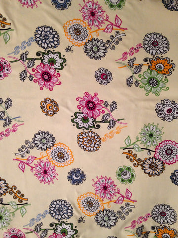 Flowers on cream cotton lycra 13oz