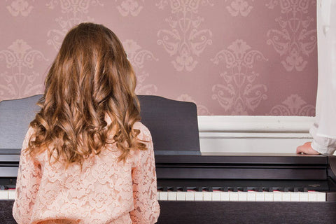 Young Child Learning Piano