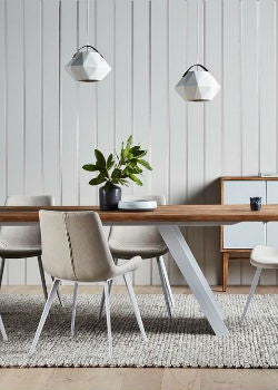 Minimal White Pendant Lights Over Dining Table | Lighting Collective