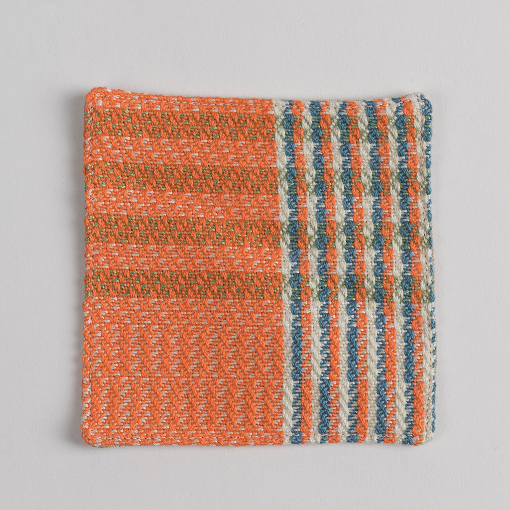 Hand woven cotton coaster - orange, front