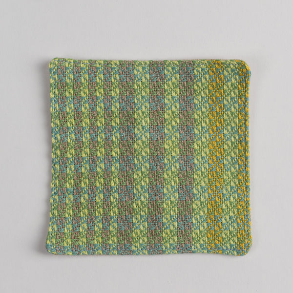 Hand woven cotton coaster - green & brown, front