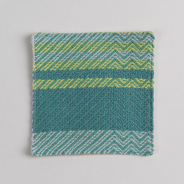 Hand woven cotton coaster - emerald green, front