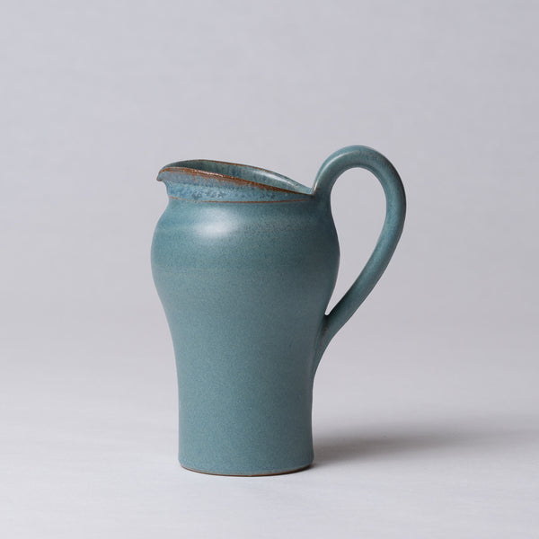 Pitcher in turquoise blue glaze