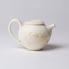 Yuko Matsuzuka, Round teapot in cream glaze flecked with ochre