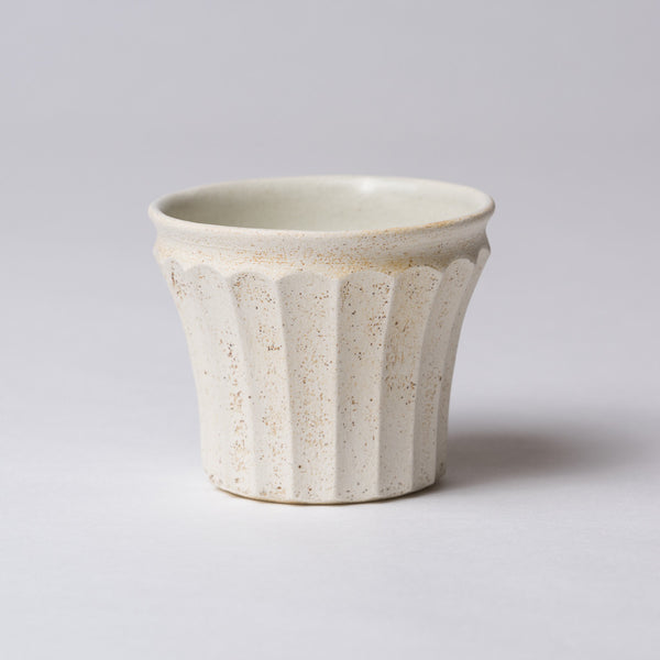 Yuko Matsuzuka, Cup with longitudinal flutes, cream glaze flecked with ochre