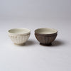 Yuko Matsuzuka, Round bowl in cream glaze flecked with ochre