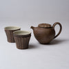 Yuko Matsuzuka, Cup with longitudinal flutes, brown glazed and teapot