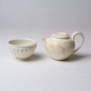 Yuko Matsuzuka, Round bowl in cream glaze flecked with ochre and teapot