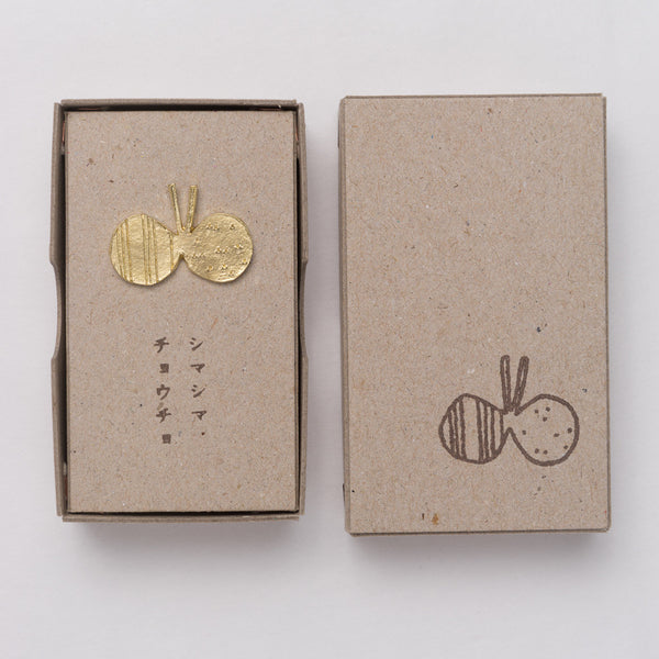 Mariko Kitano, Pin badge in brass featuring a Striped Butterfly