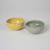 Bowl with pouring lip in olive green glaze & yello
