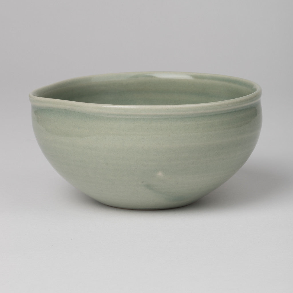 Bowl with pouring lip in olive green glaze