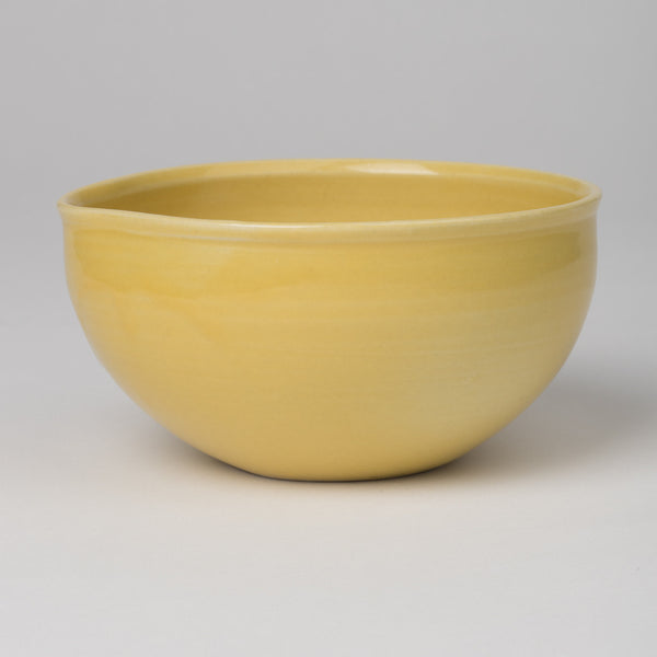 Bowl with pouring lip in yellow glaze