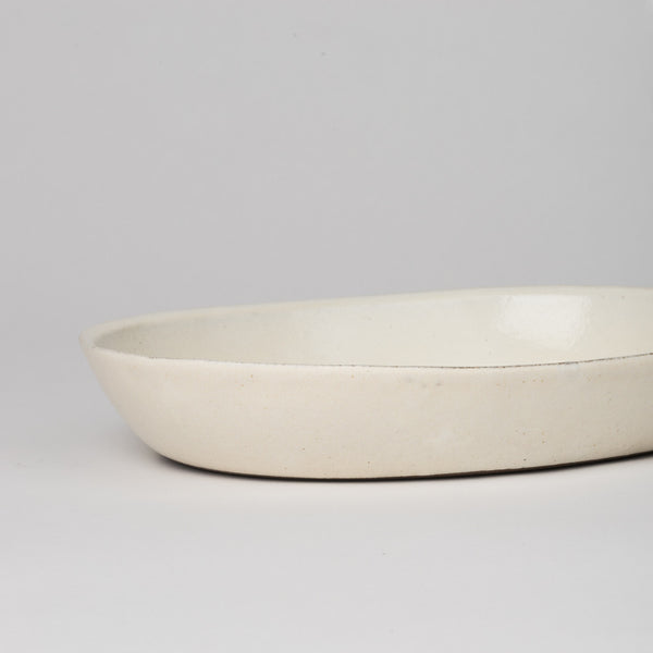 Oval dish with off-white glaze