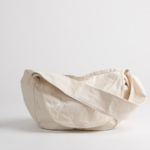Cotton canvas messenger bag in off-white, front