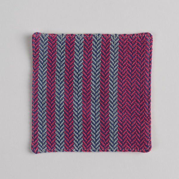 Hand woven cotton coaster - pink & violet, front