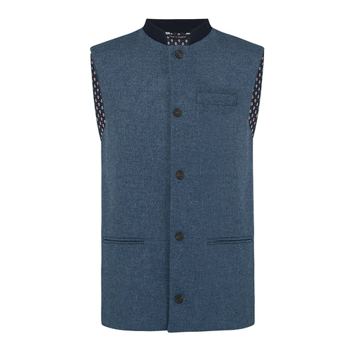 Nehru Gilet Made in England from Blue British Lambswool and a contrast Nehru collar in navy wool. Known as Nehru Vest, Nehru Waistcoat, Nehru Gilet. Finished with horn buttons. British designer, British menswear, Made in England. Smart casual Menswear.