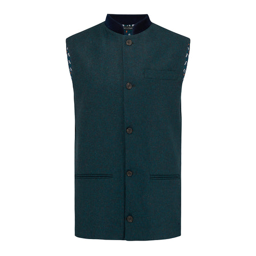 Nehru Gilet Made in England from Green Lambswool and a contrast Nehru collar in navy velvet. Known as Nehru Vest, Nehru Waistcoat, Nehru Gilet. Finished with horn buttons. British designer, British menswear, Made in England. Smart casual Menswear.