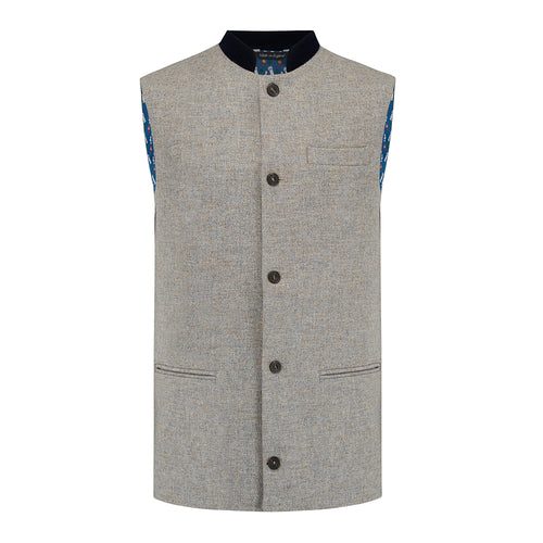 Nehru Gilet Made in England from Pale Grey British Lambswool and a contrast Nehru collar in navy wool. Known as Nehru Vest, Nehru Waistcoat, Nehru Gilet. Finished with horn buttons. British designer, British menswear, Made in England. Smart casual Menswear.