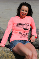 Woman wearing the Cherry Grove, Fire Island long sleeved ladies fit shirt with an anchor designed for the LGBTQ brand, Seven Even Clothing.