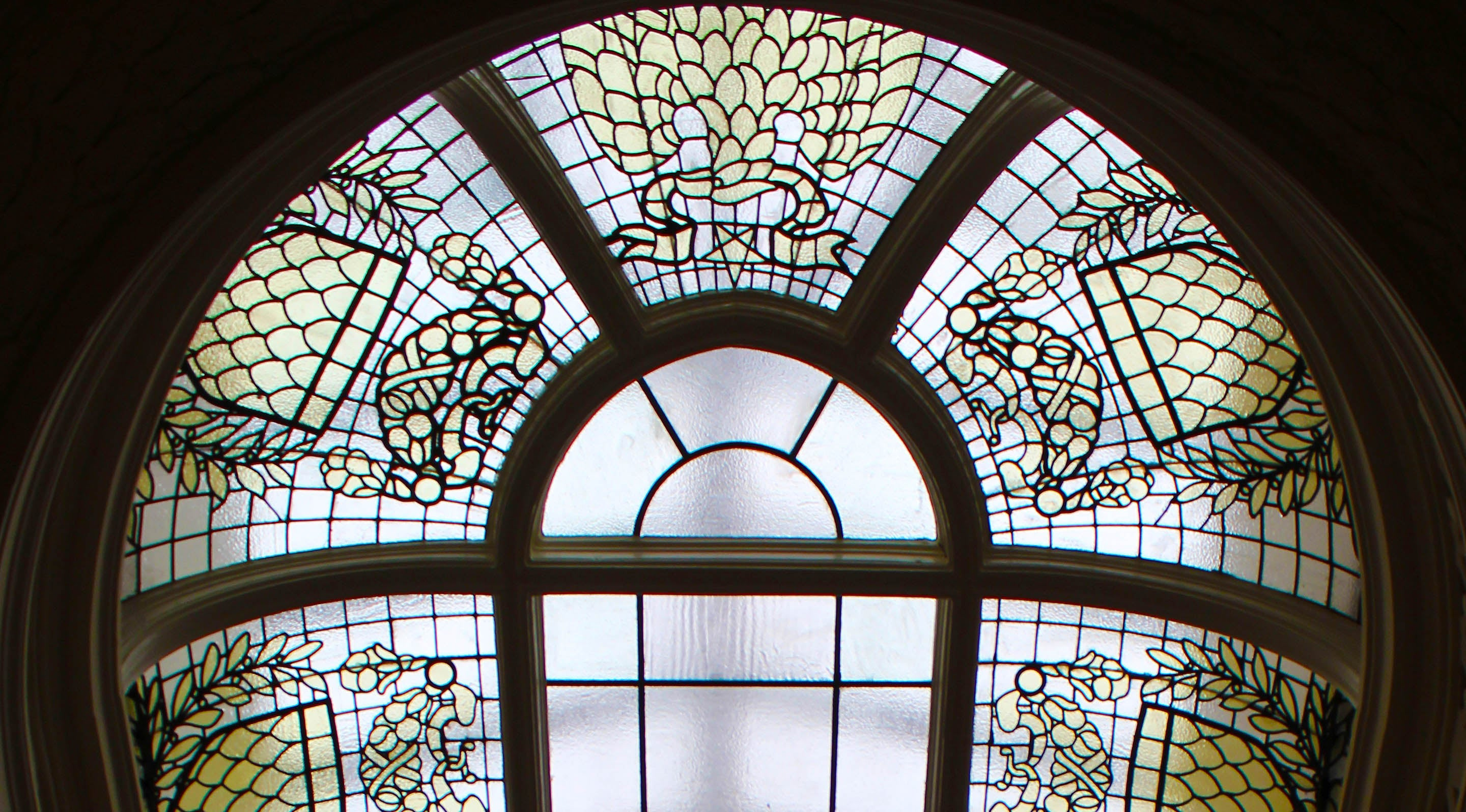 Stained Glass Above Oval Stairs, photo by Cathy Klima