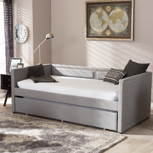 Baxton Studio Raymond Modern and Contemporary Grey Fabric Nail Heads Trimmed Sofa Twin Daybed with Roll-Out Trundle Guest Bed
