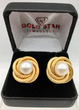 Round gold earrings with center pearl
