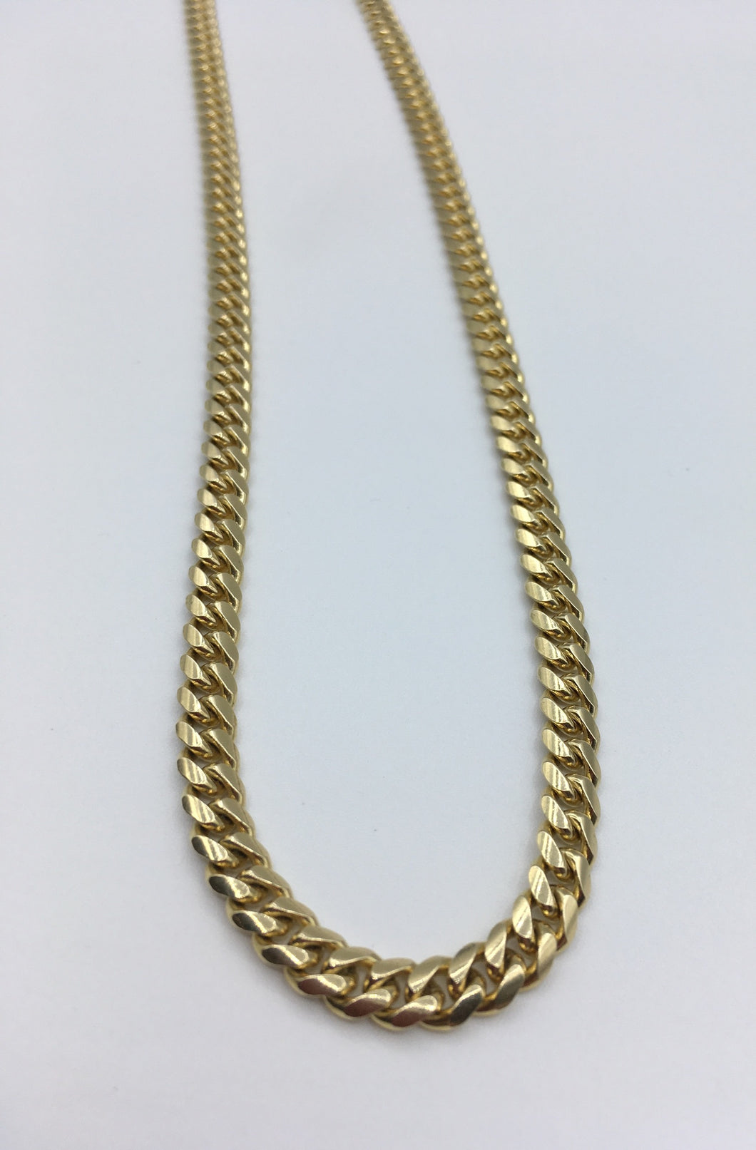 Gold curb link chain