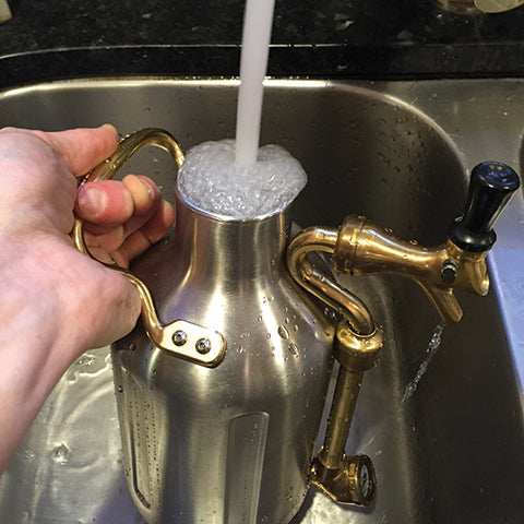 Remove cap and rinse uKeg with hot water