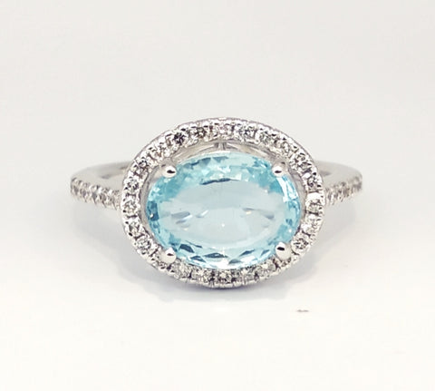 Oval Aquamarine With Round Diamond Halo Ring AD.NO- 2095