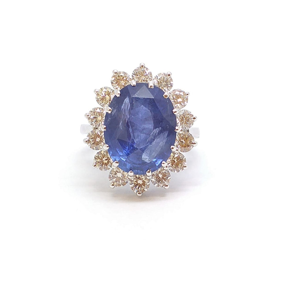 Oval Sapphire and Diamond Halo Ring in 18k White Gold