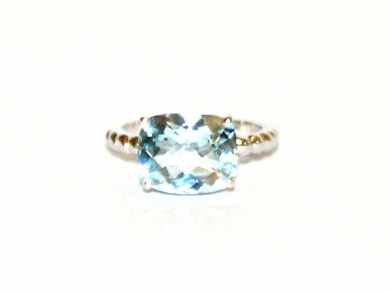 East And West Blue Topaz Ring
