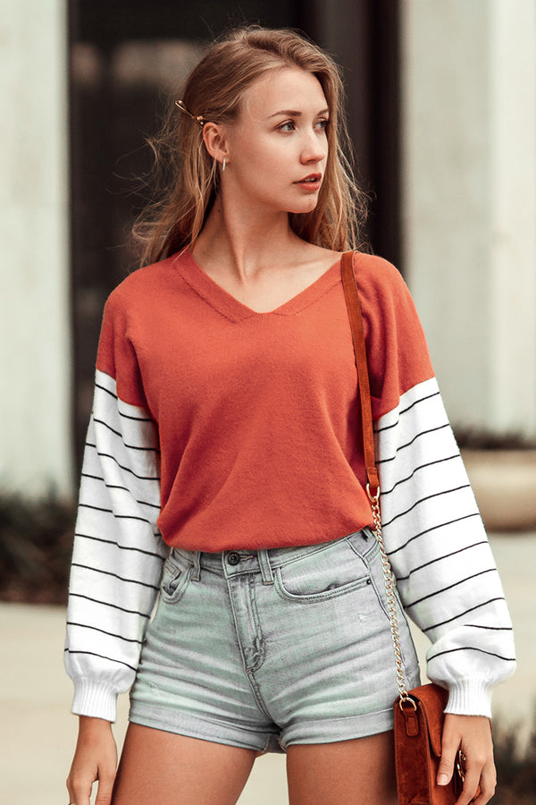 Orange and Striped Sleeve Sweater