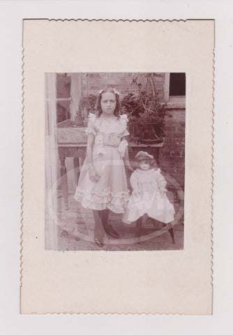 CUTE YOUNG GIRL W/ ANTIQUE PORCELAIN DOLL OUTDOOR GARDEN ANTIQUE PHOTO ON BOARD - K-townConsignments