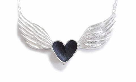 darkened patina heart with silver wings necklace