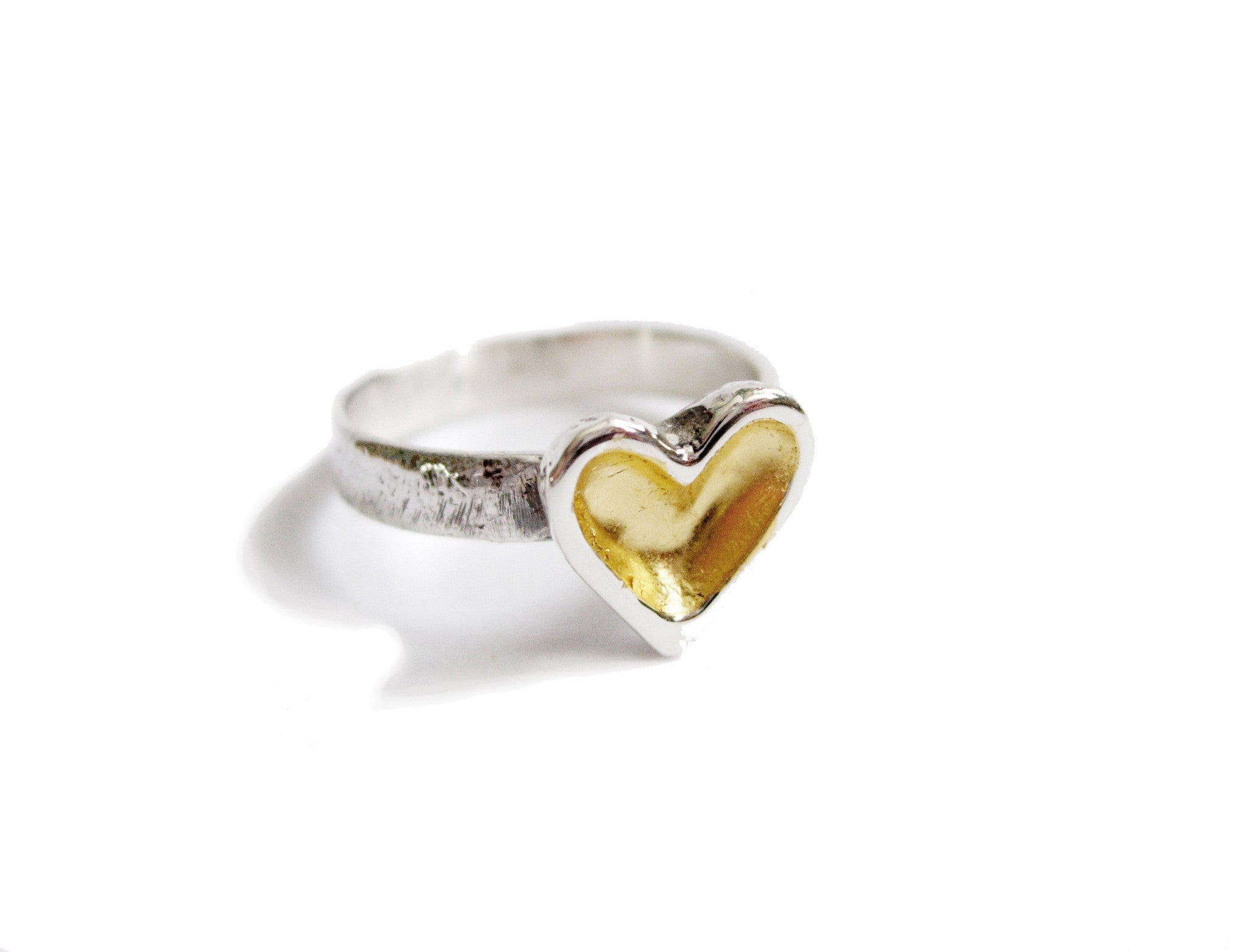 A beautiful gold leafed heart ring in sterling silver to add some loving glow to your hand.