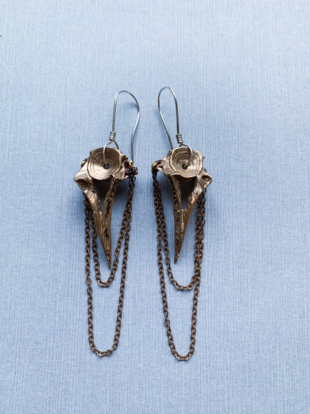 Gatekeeper earrings in bronze