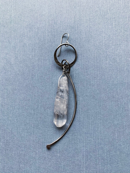 Single big quartz and silver bone earring