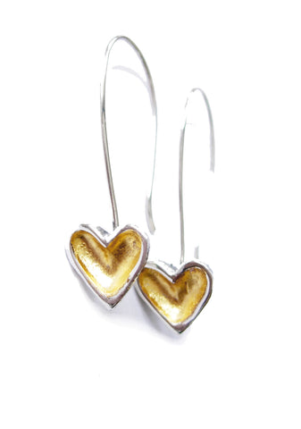 Long earrings featuring sterling silver hearts with gold leafed centres hanging from hand crafted sterling silver shepherds hooks.