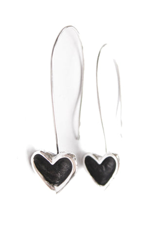 Long earrings featuring sterling silver open hearts with black patina centres hanging from hand crafted sterling silver shepherds hooks.