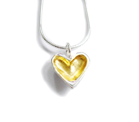petite gold and silver open heart necklace