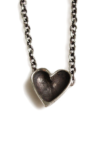 gold and silver open heart necklace with darkened chain