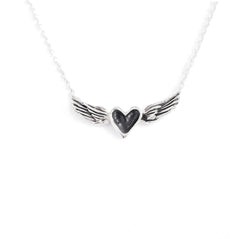 A handmade necklace featuring a small black sterling silver heart centered between sterling silver wings on a sterling silver chain. The wings have been darkened with a black patina to accent the handmade details.