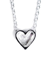 a handmade silver heart necklace