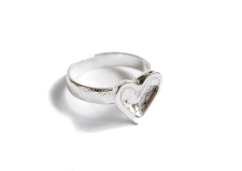 A beautiful heart ring in sterling silver to add some loving glow to your hand.