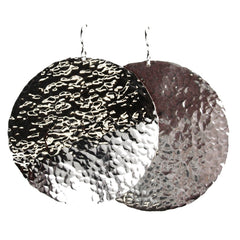 Big sterling silver sun disc earrings with a line hammered pattern.