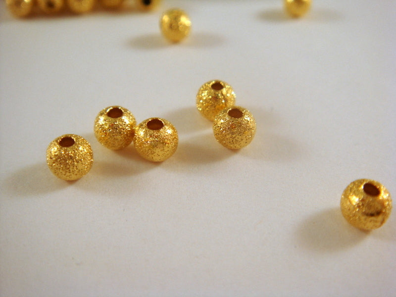 4mm Gold Stardust Beads
