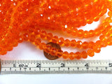 8x6mm Transparent Faceted Orange Glass Rondelle Beads