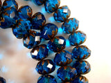 Capri Blue Transparent Faceted Cruller Rondelles