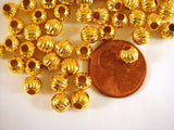 Round Corrugated Gold Melon Spacers