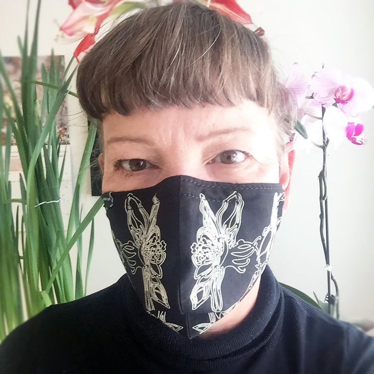 Natalija, Dock 5 artist, wearing a hand printed Columbine face cover